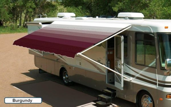 "A RV with an extended awning labeled ""Burgundy"""