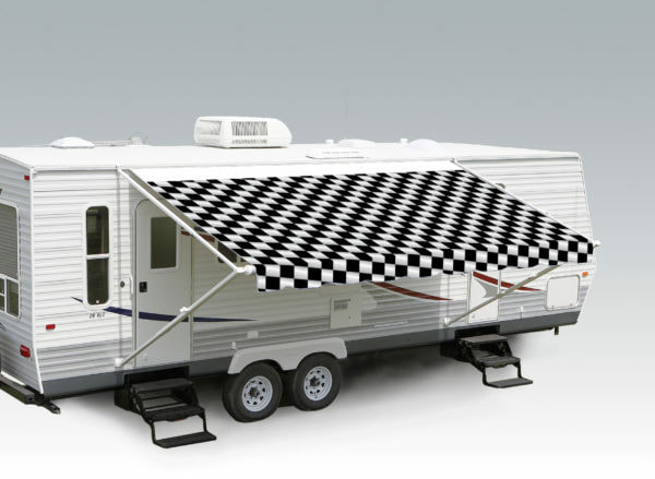 "A trailer with an extended awning labeled ""Checkered Flag"""
