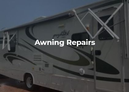 An RV with broken arms and white text in front of the image saying