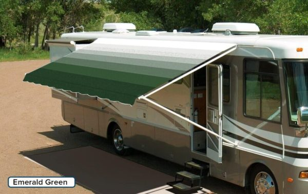 "A RV with an extended awning labeled ""Emerald Green"""