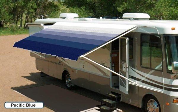 "A RV with an extended awning labeled ""Pacific Blue"""