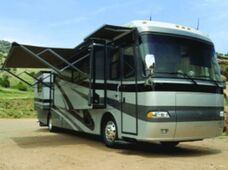 A RV in the country with an extended eclipse patio awning