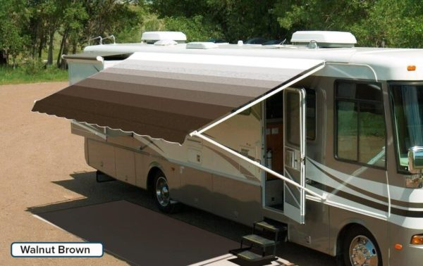 "A RV with an extended awning labeled ""Walnut Brown"""